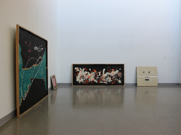 Studio view of a few paintings (from left to right: